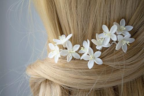 Fleurs d'oranger pour une coiffure mariée