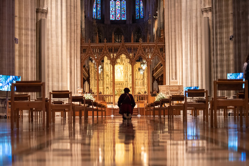 Nov. 4, 2020 A woman prays on her knee for presidential election and democracy.