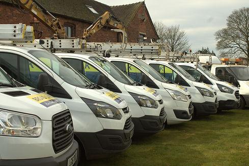 6 Broad Oak vans facing forwards.