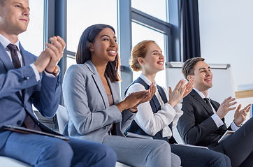 young-colleagues-applauding-to-presentat