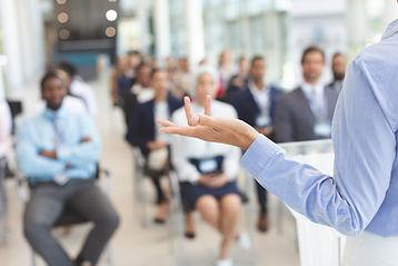 female-speaker-speaks-to-diverse-business-people-i-R6W9K8J.jpg