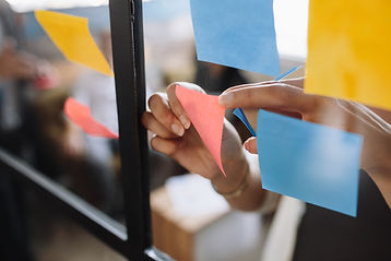hands-of-woman-sticking-adhesive-notes-o