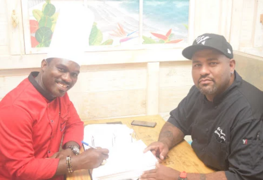 Chefs Neville Nugent (left) and Ed Reynoso (right) sit in the soon to open Mad Cow Grill!