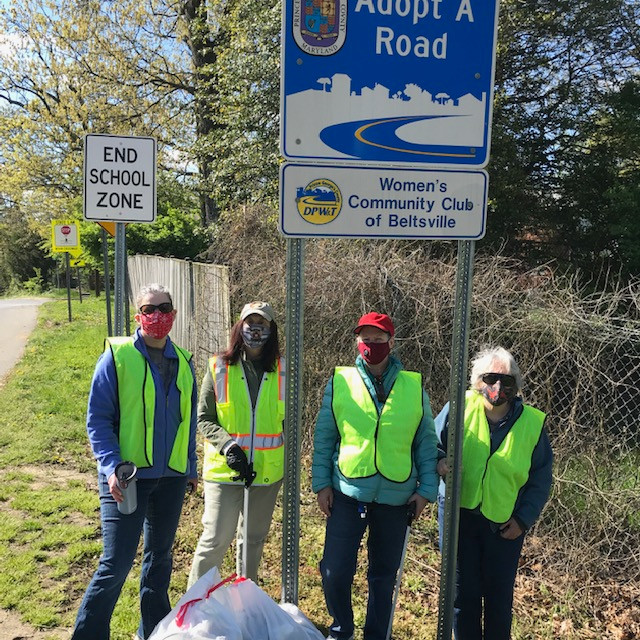 Members of the Women's Community Club of Beltsville helping to clean up Montgomery Road.