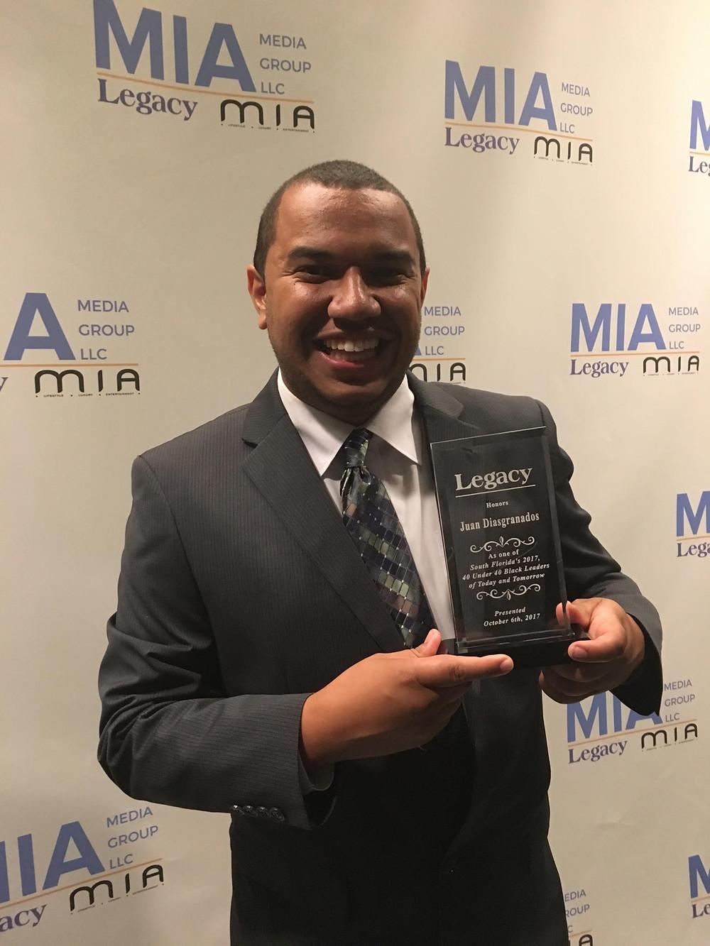 Juan Diasgranados proudly displays his Legacy Award.