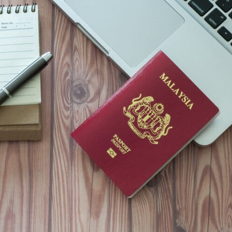 Why is Malaysia's passport red?