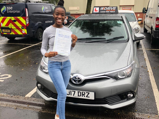 Female driving instructor in Rochdale gets a first time pass. Take driving lessons now.