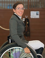 Paradressage rider alanna flax-clark rides horses in wheelchair. Equestrian doing dressage.