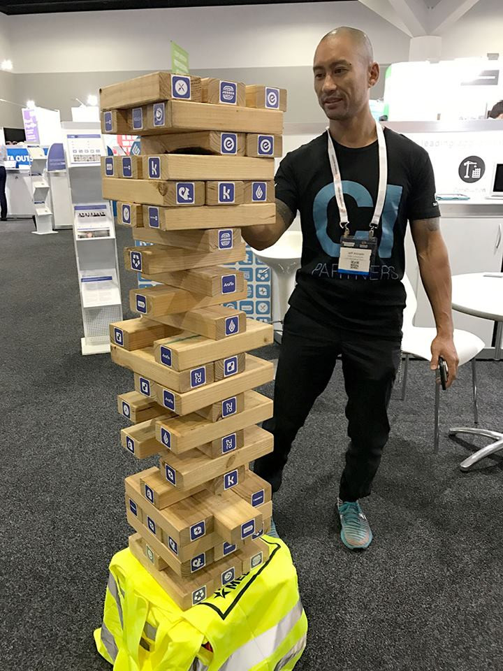 Jeff Solving the Add-on Puzzle with our giant Jenga