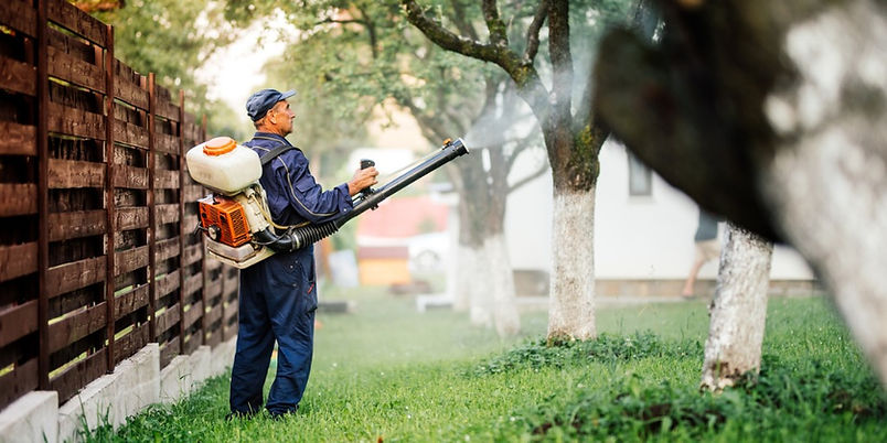 farmer-worker-spraying-pesticide-treatme
