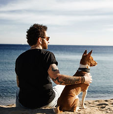 Handsome tattooed man with his dog