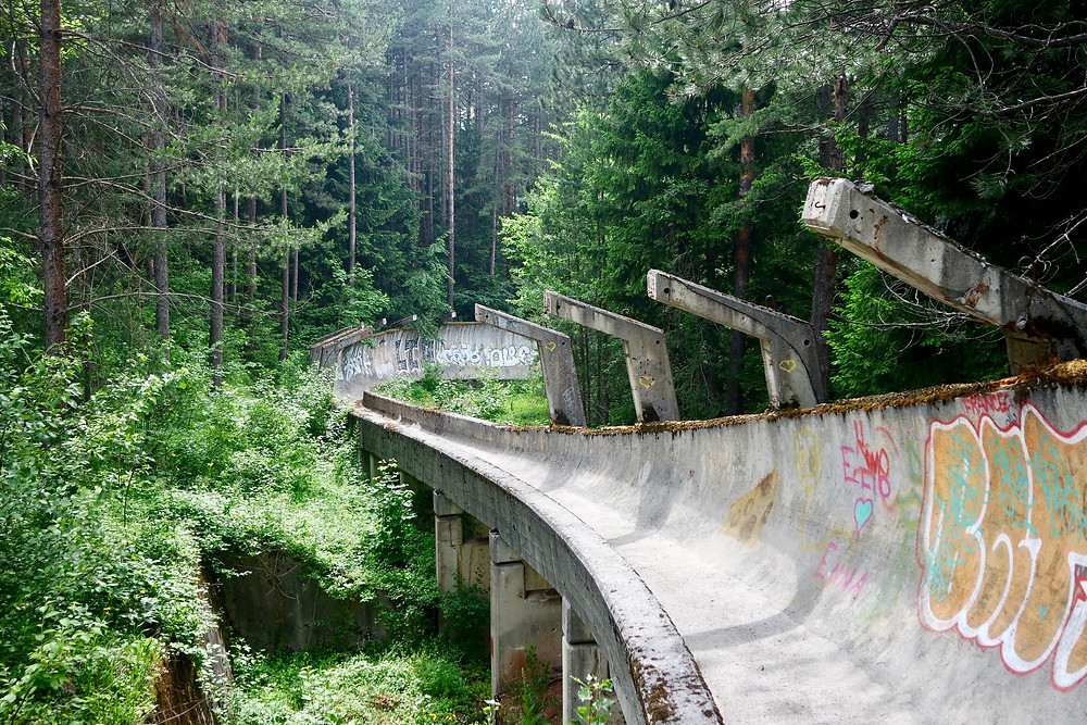 Urban Exploration: abandoned bobsleigh track surrounded by forest in Sarajevo, Bosnia and Herzegovina.