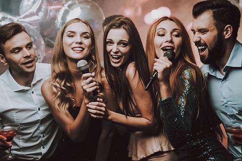 group-of-friends-singing-karaoke.jpg