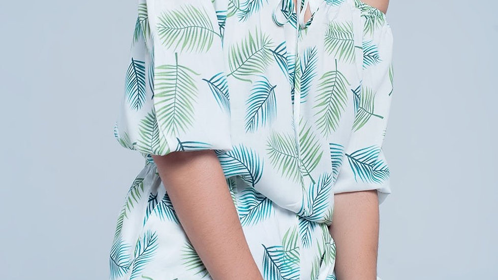 White jumpsuit with tropical leaf print