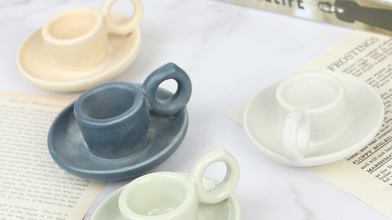 Cup-Shaped Candlestick Holders