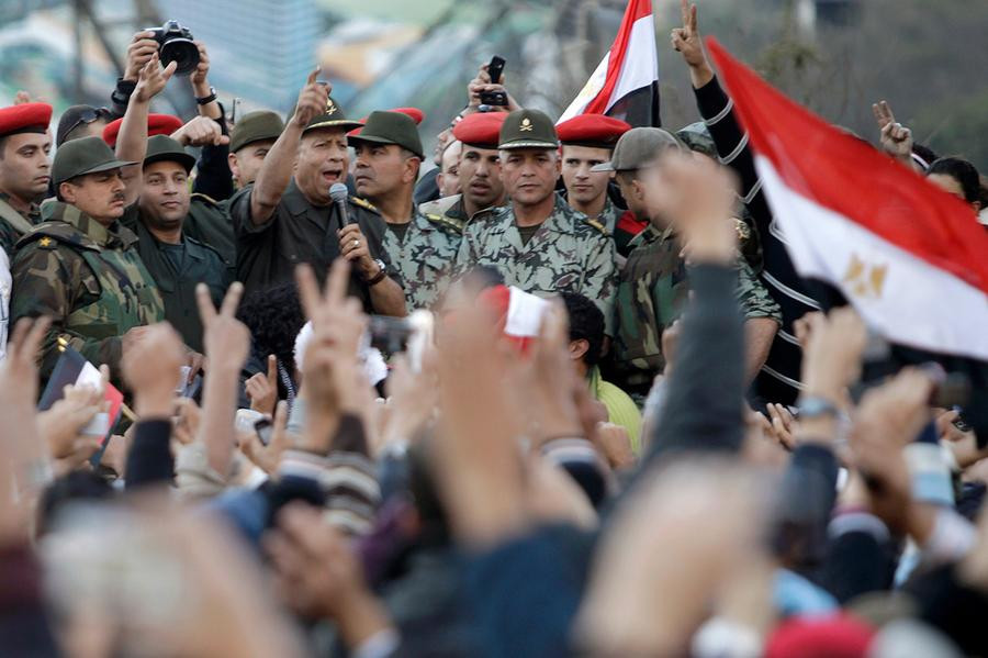Military Generals talking to protesters at Tahrir Square during Egypt's revolution against Mubarak in 2011