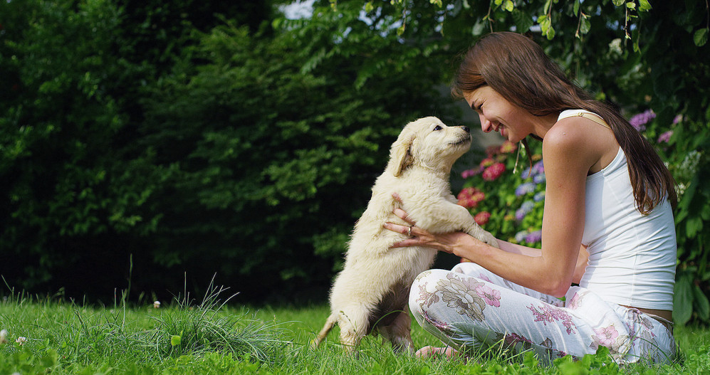 Smiling woman with puppy