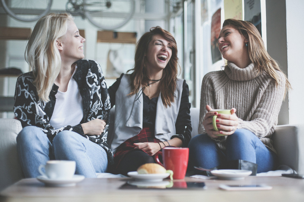 three girlfriends laughing