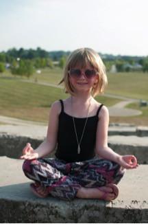 Little girl in yoga pose