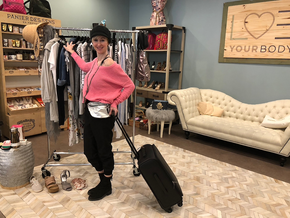 Lisa Berry holding a carry-on suitcase