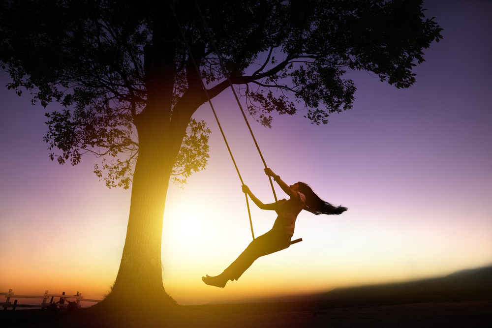 woman swinging on a tree swing