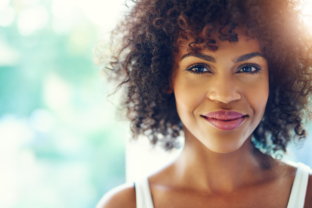 Woman smiling with kindness in her eyes