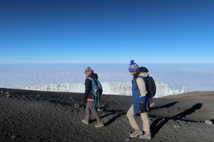 Megan making the final trek to the summit of Mt Kilimanjaro