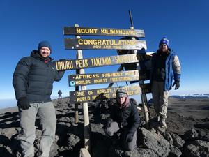 Megan at the top of Mt Kili celebrating a successful summit