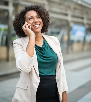 Professional Women taking a business phone call outside office