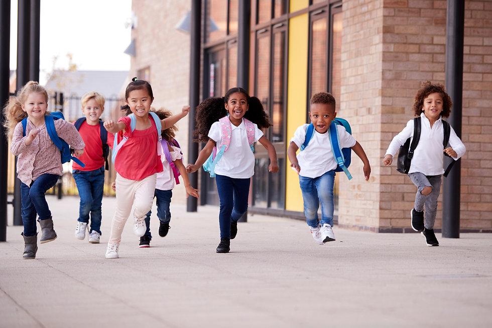 smiling-multi-ethnic-school-kids-running