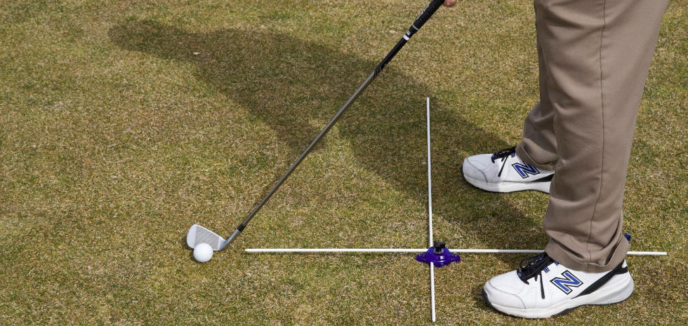 A One Golf Puck set for quick pre-round warmup to check body alignment, aim, and the distance to stand from the ball at address.