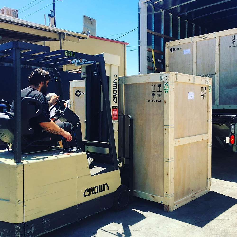 Loading up the truck with fiber laser cutters