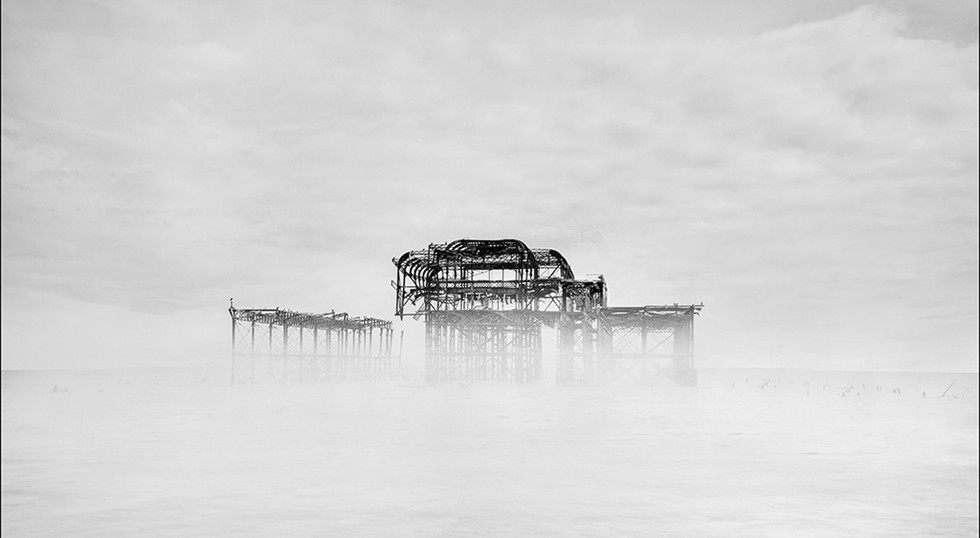 Old Brighton Pier Rising from the Mist by Les Thwaites