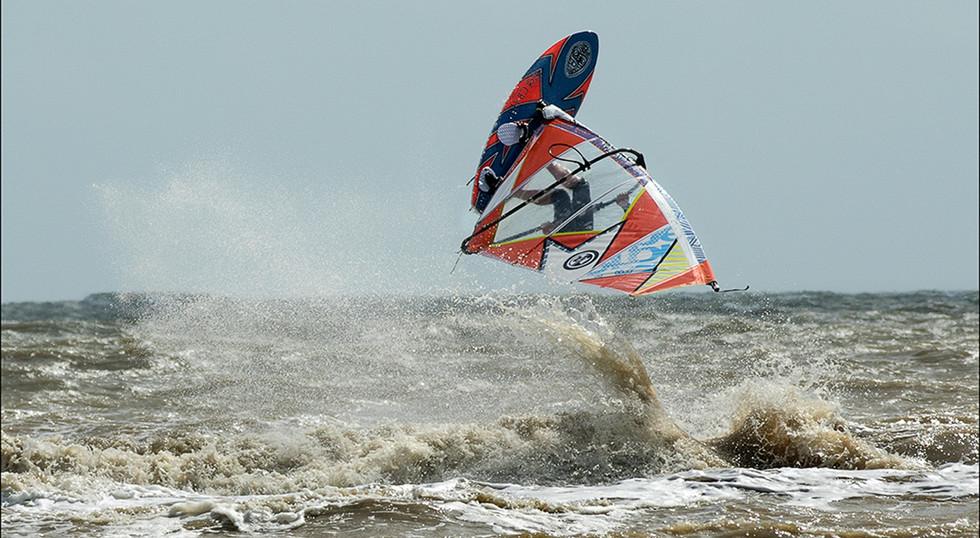 Upside Down Surfer by Les Thwaites