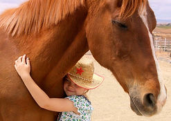 girl hugging horse.jpg