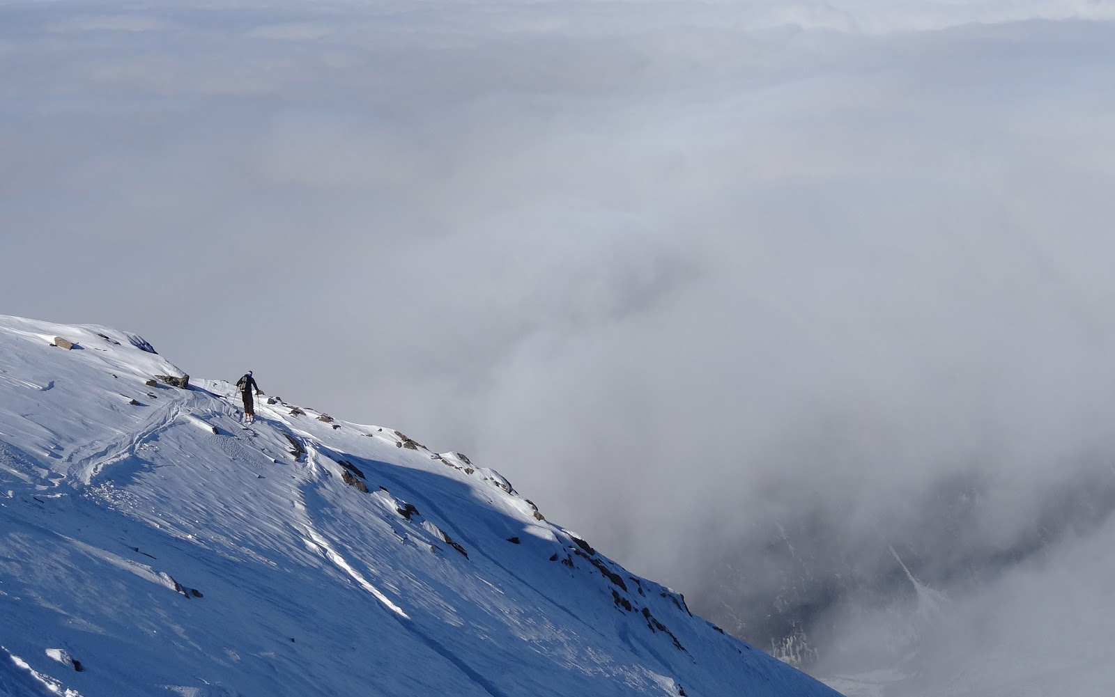 Will Eaton skiing above the clouds.