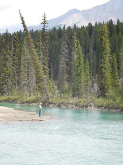 A lone fisherman, Alberta, Canada.