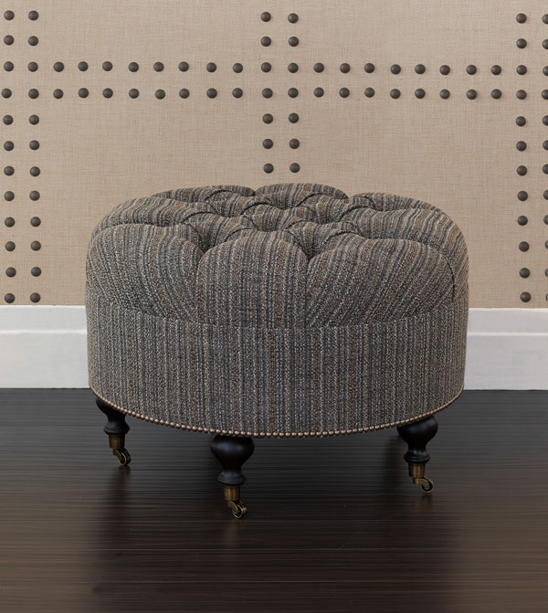 After: The Cleo ottoman upholstered in Rosenthal Dusk with Espresso Wood-stained castors and a single row of nailhead detailing.