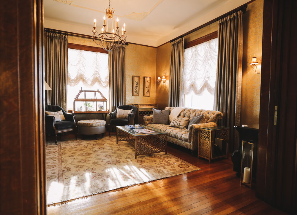 A downstairs common-room complete with gilded wallpaper