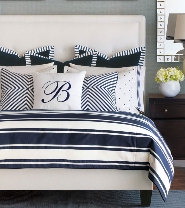 By seashore or lakeside, Barclay brings his own unmistakable flair to glamorous summertime living. From a skilfully mitered geometric pillow to its polka-dot embroidered shams, each piece is crafted with a precise attention to detail. Its diversity in texture and pattern is soothed by a classic blue and white color palette - restful as a summer day.