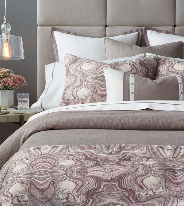 Celebrate some of nature's most beautiful and complex structures with Zendaya. Featuring an agate design in mauve and amethyst tones, it pairs an intricate mineral pattern with a refreshing, streamlined silhouette. Complete the look with linen euro shams and a decorative bolster featuring nailhead detailing.