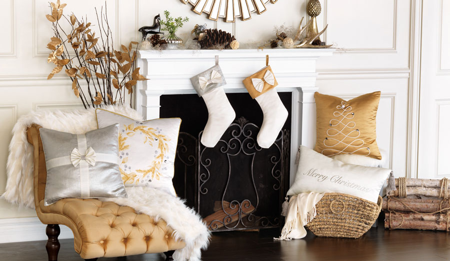Celebrate the holidays the glamorous way with this collection of stylish and sophisticated decorative throw pillows and stockings. From curly-cue Christmas trees and jeweled wreaths to furry Santa hat appliques and ribbon detailing, each pillow shines in timeless silvers and golds. Add one of our our bow-detailed stockings for a positively debonair look.