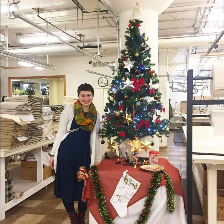 Here's Sage, head of the Drapery and Hardware, with her department's tree -- already piling up with presents for their Gift Swap