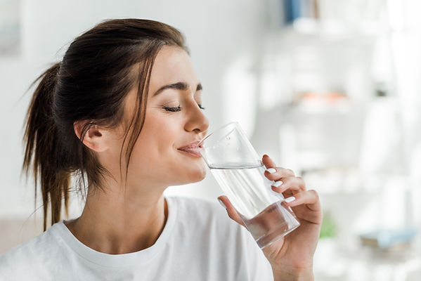 smiling-girl-holding-drinking-water-from