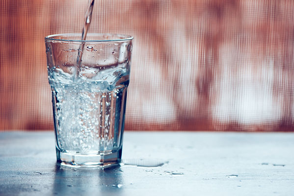 pouring-fizzy-water-into-drinking-glass-