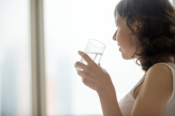 young-woman-with-glass-of-water-PXYS6AH.