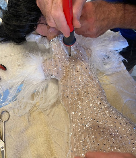 Hand beading and feathering