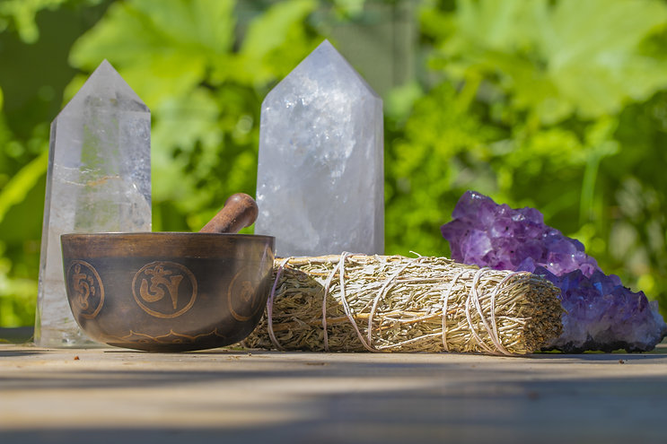 Crystals, smudge stick, and singing bowl to represent energetic healing in Hawaii.