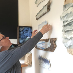 The artist hanging Storm Imogen response pieces