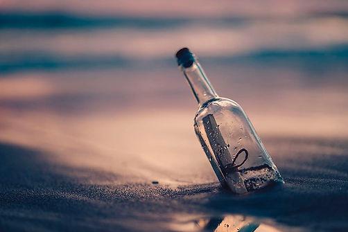 bottle-sand-beach-coast.jpg